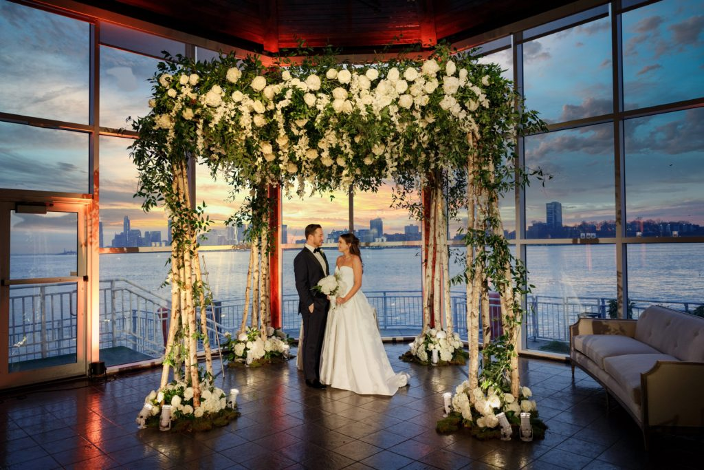 Chuppah with Bride and Groom before Ceremony starts, Hudson River Sunset in the background