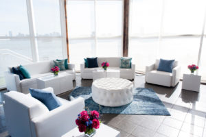white sofas in The lighthouse with colorful pillows