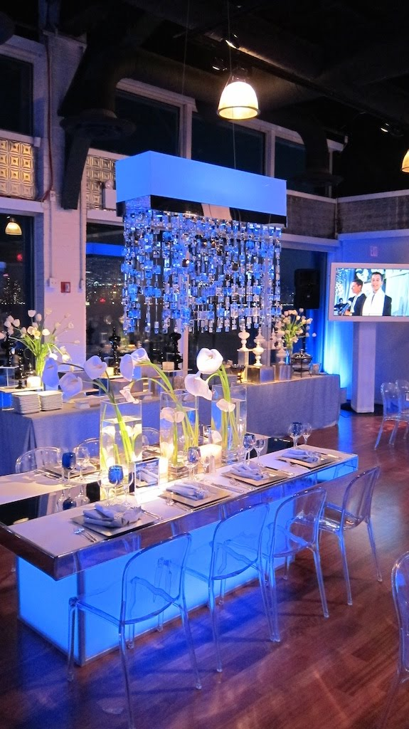 Mitzvah Table Set up decor in a white and blue theme with hanging chandeliers
