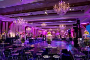 Mitzvah set up for dinner with highboy tables and barstools, chandeliers added.