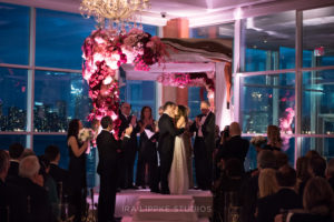 Wedding Ceremony at Pier Sixty, Chuppah and water views in the background