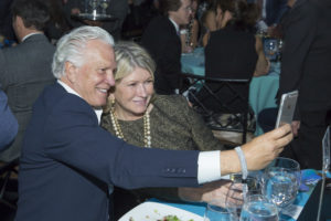 Martha Stewart taking a selfie with a guest