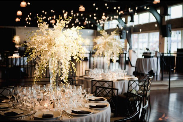 Candlelit table with floral arrangement