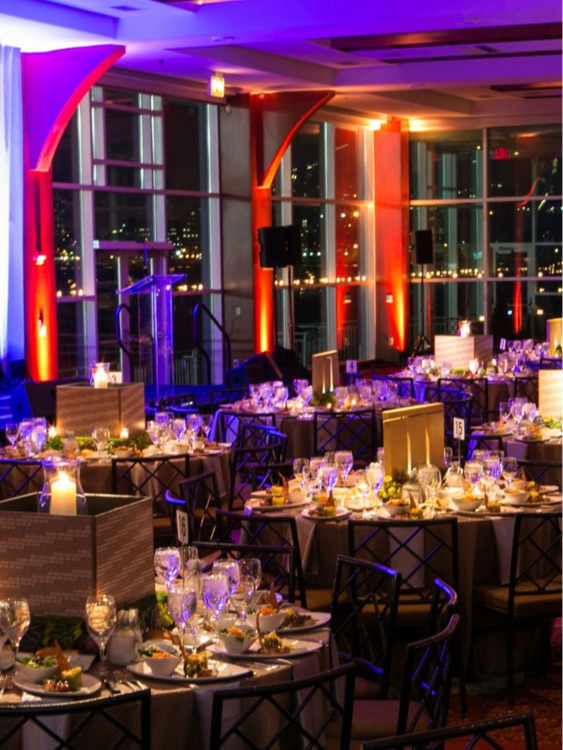 Dinner tables set for corporate event
