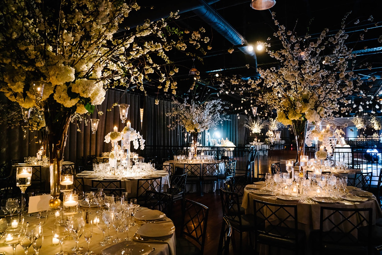 Dinner tables with extravagant floral arrangements