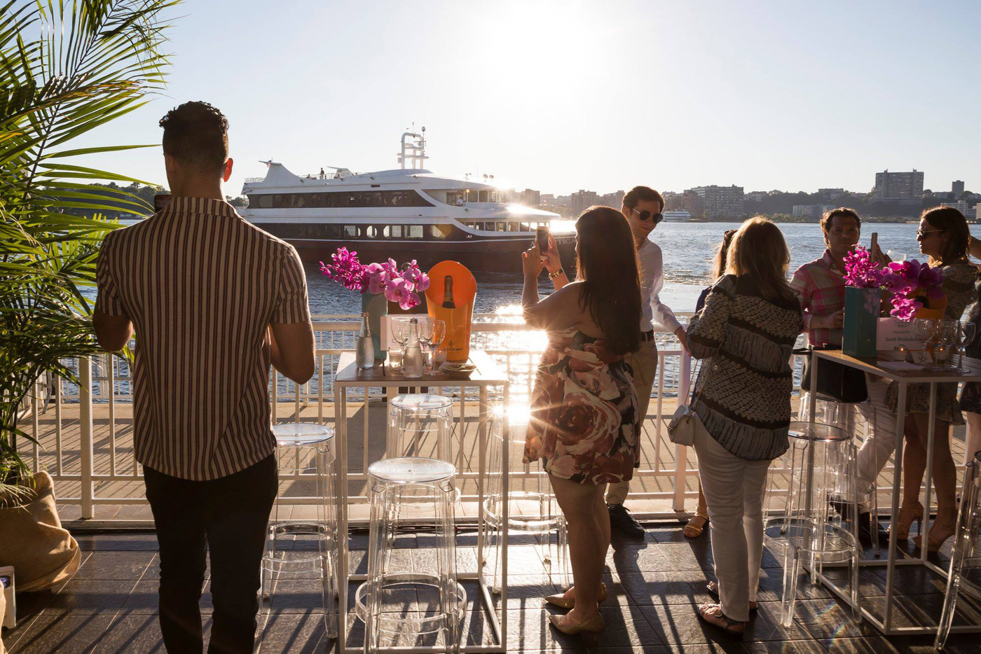Guests mingling in front of yacht