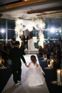 a boy and a girl walking down the aisle