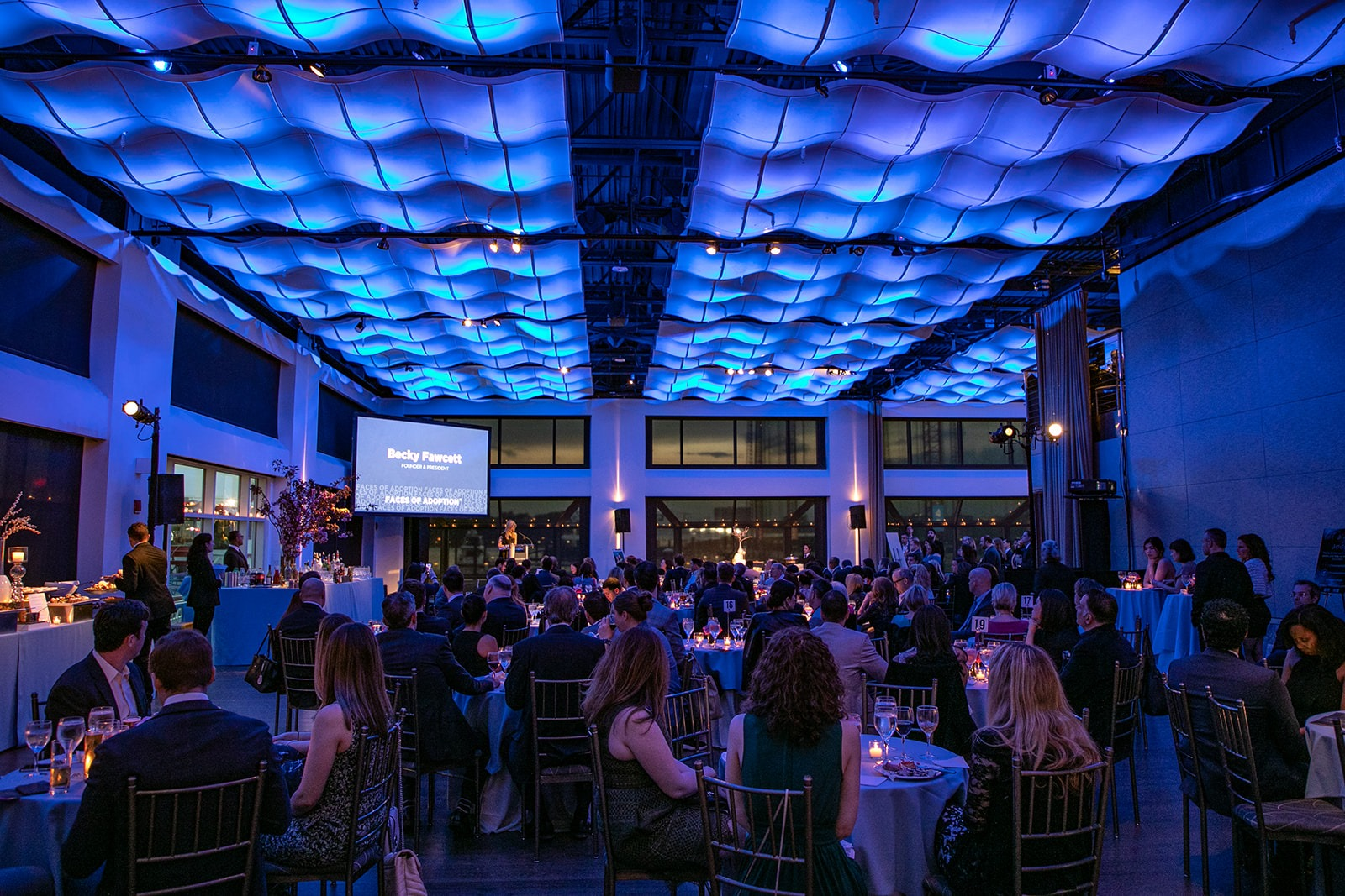 Current in Blue LED ceiling lights with guests seated at tables