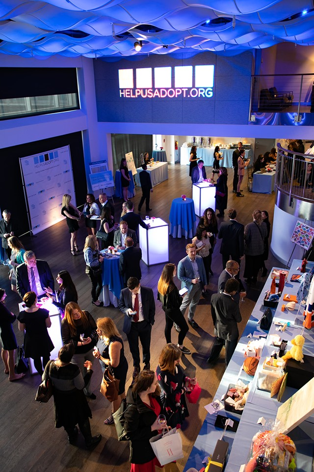 Current in Blue ceiling LED Lights, guests standing during cocktail hour