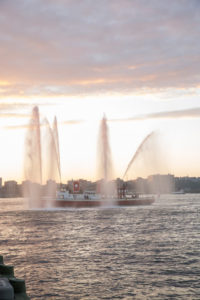 Rescue boat spraying water into the ait