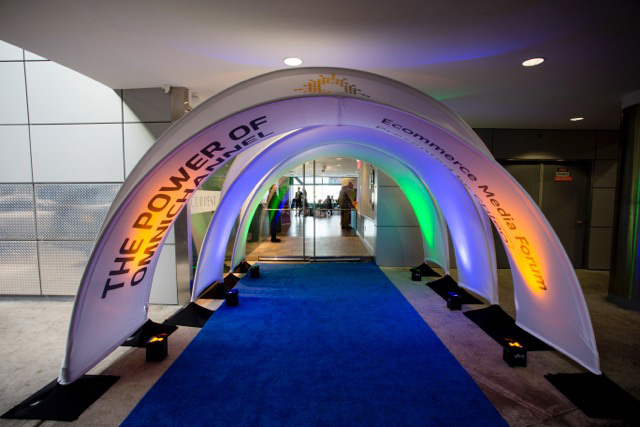 branded entrance created as tunnel with a blue carpet and fabric arches