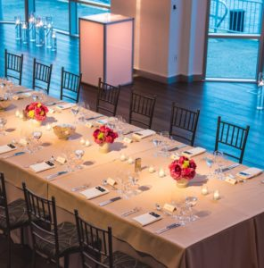 Long dinner table set at Current