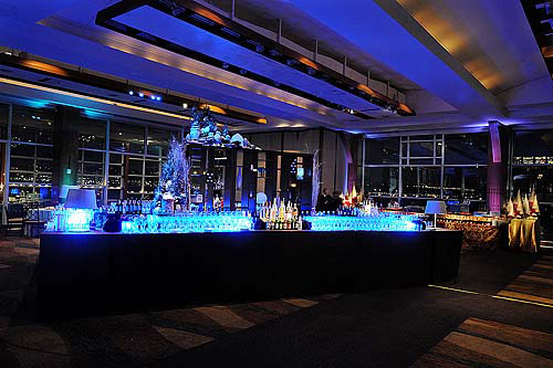 Blue lit holiday cocktail bar