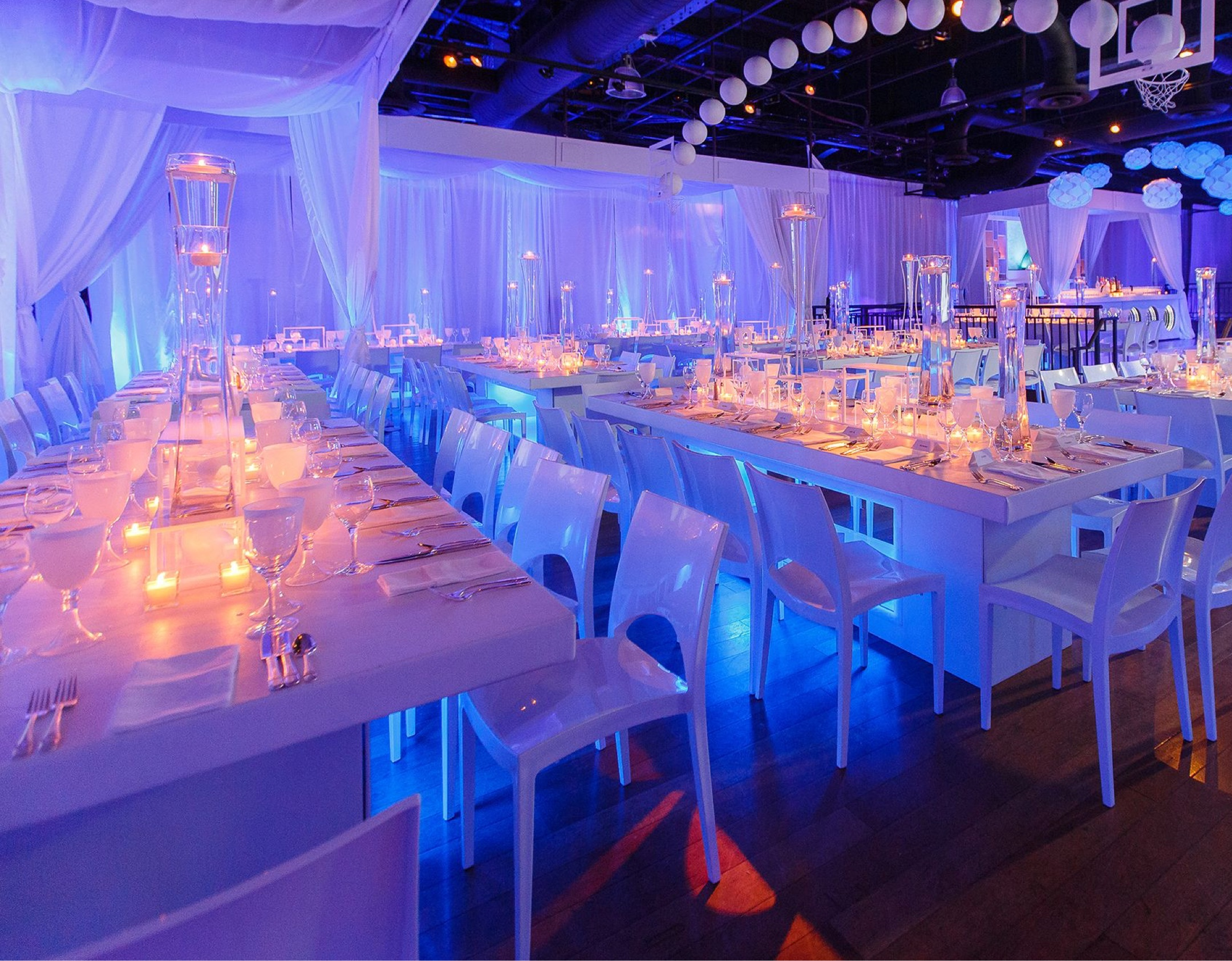 Blue and purple mood-lit dinner tables