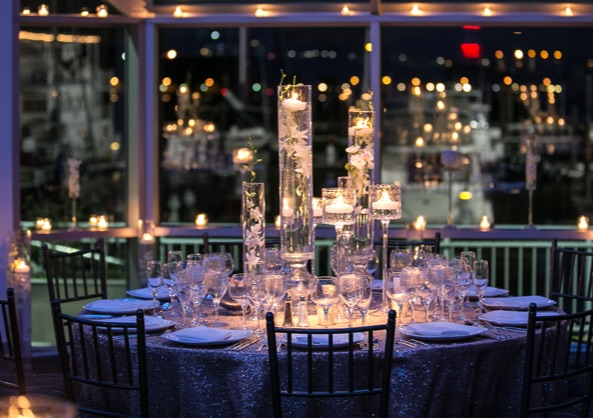 Dinner table set with glass candelabras