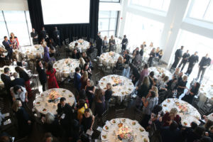 Guests mingling among tables