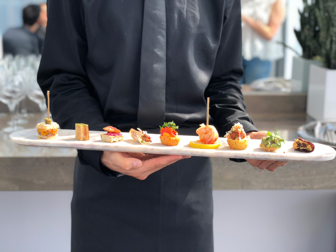 Tray of appetizers held by waiter