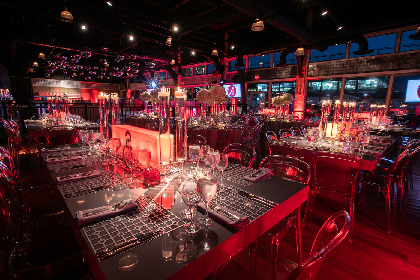 Tables set for Mitzvah with red lighting