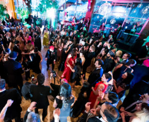 Partygoers dancing on the dancefloor