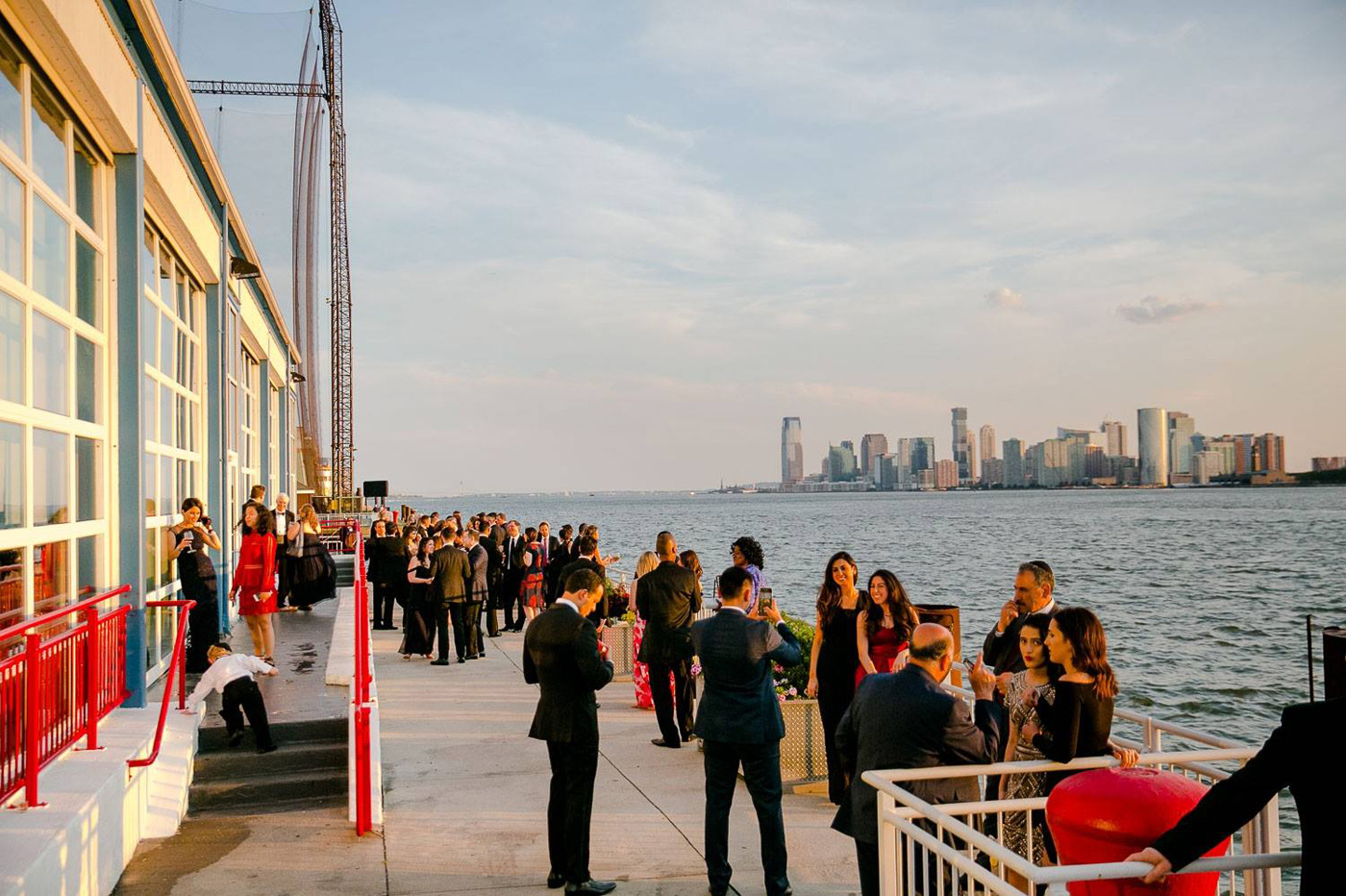 guests standing in the veranda by the hudson river