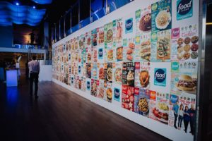 Long wall covered in Food Network magazine covers.