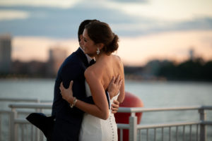 Bride and Groom hugging in front of the Hudson River