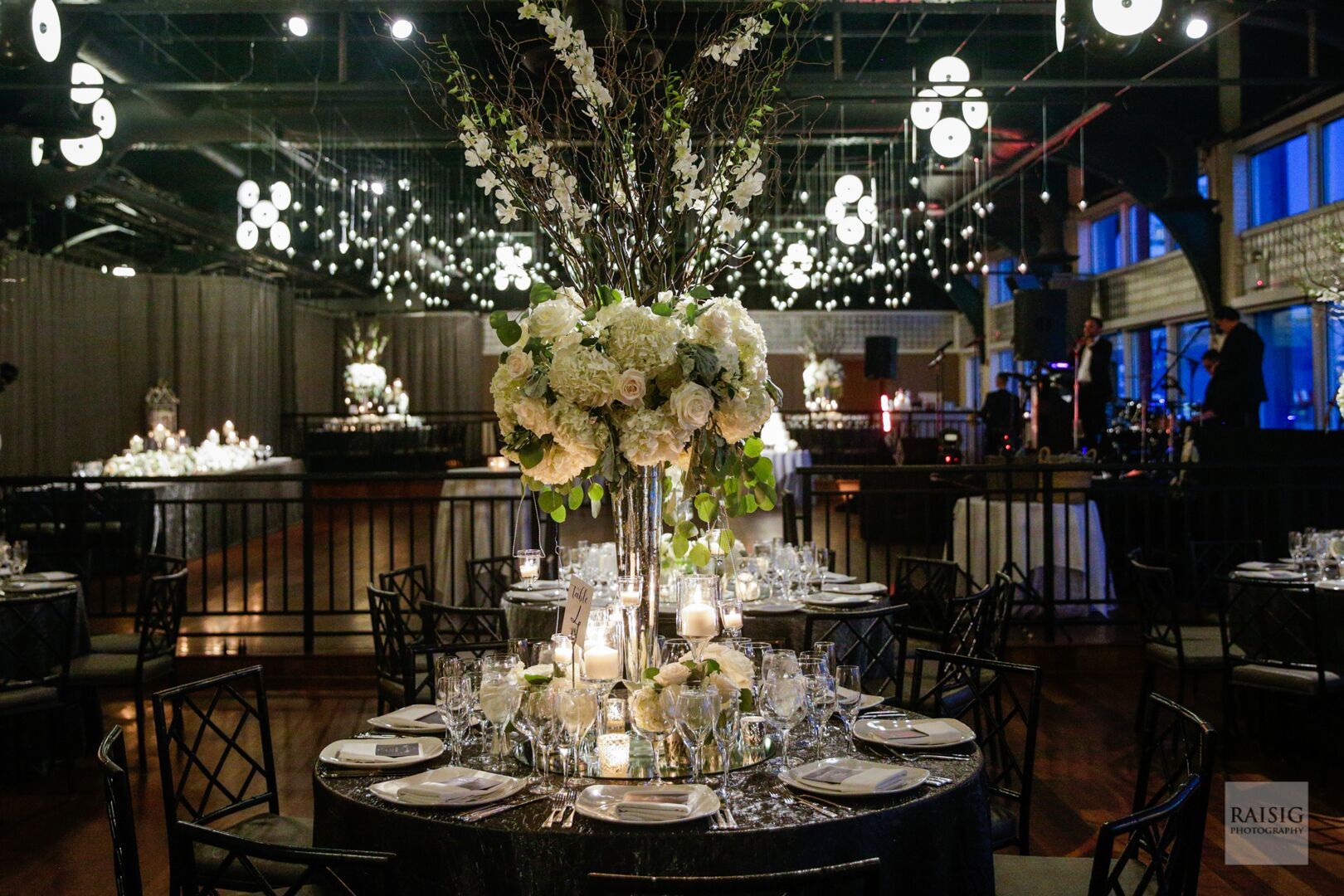 Candlelit tables with floral arrangement