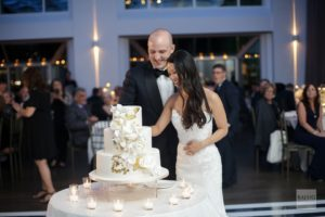 Current bride and groom cutting the cake