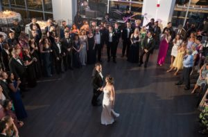 Bride and Groom dancing in the middle of the dance floor while all guests are in a circle around at Current