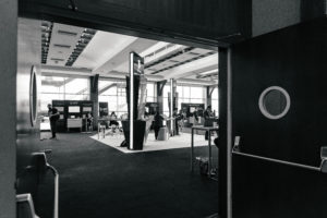 black and white picture taken from the foyer into Majestic where there exhibit booths