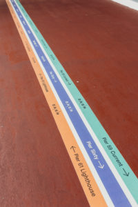 Decals on the floor of the complex to guide guests when moving from venue to venue