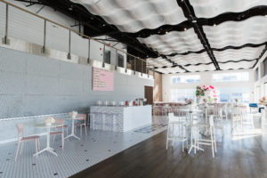 Current Mitzvah Set up in a light colors with a coffee shop feel