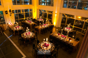 Current Mitzvah in a gold theme picture of tables from above