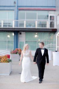 bride and groom walking in the Current Veranda