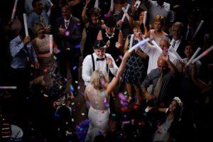 Bride is dancing with glow sticks in dancefloor at Current