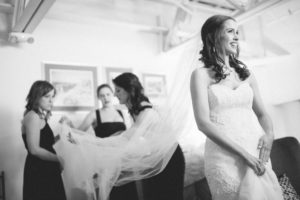 bride is getting ready in her private suite with bridesmaids