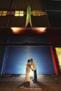 bride and groom kissing outside in Chelsea Piers