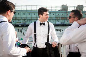 Groom and groomsmen standing in the veranda of Current
