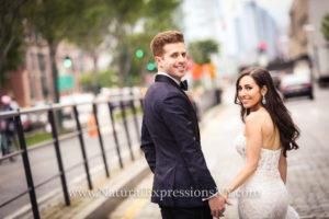 Bride and Groom walking in Chelsea piers complex