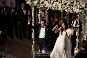 bride and groom celebrating saying I DO by the Chuppah at Current