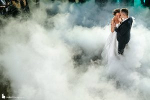 Bride and Groom dancing around smoke at Current