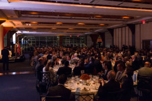 Pier SIxty Gala with speaker on stage behind podium